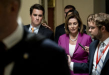 WASHINGTON, DC - JULY 16: U.S. House Speaker Nancy Pelosi (D-CA) speaks to the members of the media as she makes her way to the House chamber to vote on a resolution denouncing comments by President Trump targeting four progressive Democratic congresswomen of color on July 16, 2019 in Washington, DC. The resolution passed 240-187, with Republicans Will Hurd (R-TX), Brian Fitzpatrick (R-PA), Fred Upton (R-MI) Susan Brooks (R-IN) and independent Justin Amash (I-MI) joining Democrats. (Photo by Pete Marovich/Getty Images)