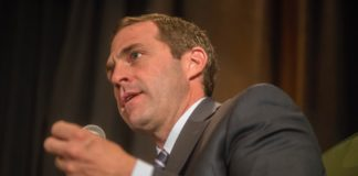Colorado's U.S. Rep. Jason Crow speaks on panel at the annual Colorado Chamber of Commerce luncheon at the Ritz Carlton hotel in downtown Denver on Aug. 22, 2019. Crow is among seven House Democrats who will present the case for the impeachment of President Donald Trump to the U.S. Senate. (Photo by Evan Semón)